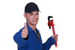 Man with a wrench Stock Photo