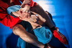 Man wrestler makes submission wrestling royalty free stock images