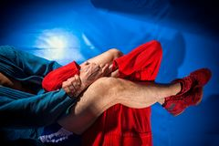 Man wrestler makes submission wrestling. Man wrestlers of grappling and jiu jitsu in a blue and red kimono makes submission wrestling. Fighting techniques royalty free stock image