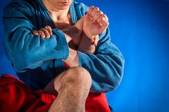 Man wrestler makes submission wrestling. Man wrestlers of grappling and jiu jitsu in a blue and red kimono makes submission wrestling. Fighting techniques stock images