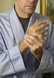 Man wringing hands in pain_3 Stock Photo