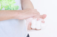 Man with wrist break and gypsum bandage and elastic bandage outdoor close up holding hands crossed. royalty free stock photography
