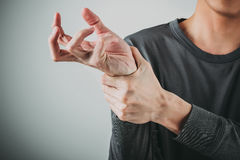 Man wrist pain. Man have a wrist pain Royalty Free Stock Photos