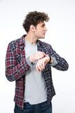 Man with wristwatch looking away. Portrait of a young man with wristwatch looking away Royalty Free Stock Image