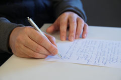 Man write letter. At the desk royalty free stock photos