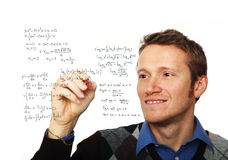 Man write maths formula. Portrait of young man writing on glass board isolated on white Royalty Free Stock Photography