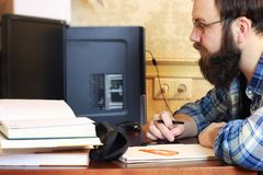 Man write pen table. Man write pen in a note pad on a table Stock Image