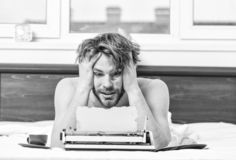 Man writer lay bed with breakfast working. Writer handsome author used old fashioned manual typewriter. Morning bring stock image
