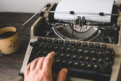 Man Writer Typing On A Old Typewriter. Journalism Report Concept Royalty Free Stock Photos