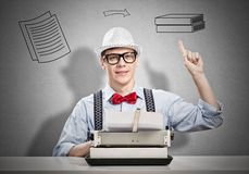 Man writer. Young man writer with typing machine waiting for inspiration Royalty Free Stock Photos