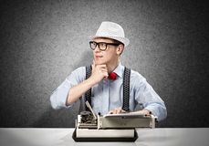 Man writer. Young man writer with typing machine waiting for inspiration Stock Photos
