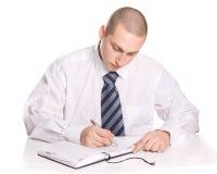 The man writes. Stock Photos