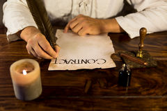 Man writes a contract. Medieval man writes a contract Royalty Free Stock Photos