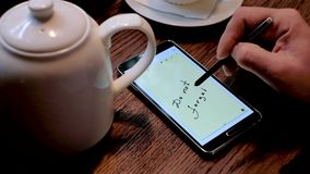 Man writes do not forget text on the smart phone screen stock footage