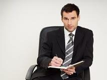 Man writes document Stock Images