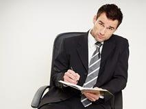 Man writes document Stock Image