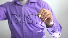 Man writes on glass the word business the idea of innovation stock footage