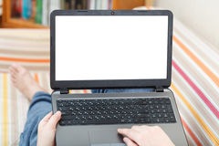 Man writes on laptop with cut out screen Stock Photography