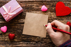 Man writes a love note Stock Photos