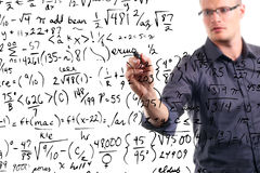 Man writes mathematical equations on whiteboard royalty free stock images