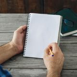 Man writes in a notebook close up. Man writes in a notebook close-up Royalty Free Stock Image