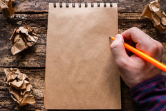 Man writes in a notebook Royalty Free Stock Photos