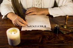 Man writes on parchment freedom Royalty Free Stock Image