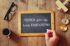 Man writes a phrase: NEVER GIVE UP, KEEP DREAMING Royalty Free Stock Photography