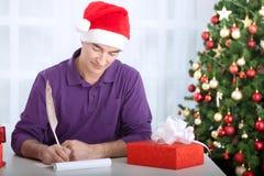 Man writes wishes Stock Image