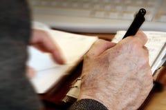 Man writing Stock Photography
