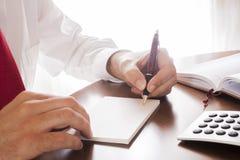 Man writing Stock Photos