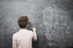 Man Writing On Blackboard Royalty Free Stock Image
