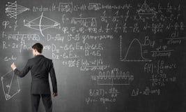 Man writing on blackboard Stock Images