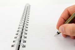 Man writing in a blank notebook Royalty Free Stock Photos