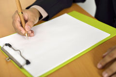 Man Writing On Blank Paper Stock Photo
