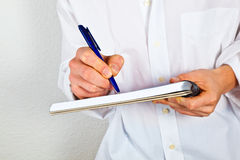 Man writing in a book Royalty Free Stock Photo