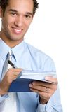 Man Writing Check. Smiling business man writing check Royalty Free Stock Photography