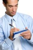 Man Writing Check. Isolated business man writing check Stock Photo