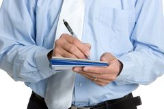 Man Writing Check. Isolated business man writing check Stock Photos