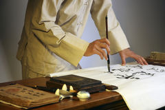 Man writing chinese calligraphy stock images