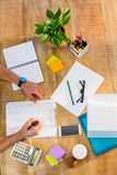Man writing on clipboard Stock Images