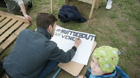Man writing Come to Nuit de Debout stock video footage