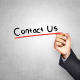 Man Writing Contact Us Text Royalty Free Stock Photos