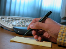 Man writing a contract 2 Stock Image