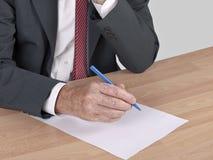 Man writing at desk - resignation Stock Photos