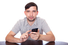Man writing e-mail with smartphone. Man with smartphone. Talking, Writeing and reading sms Royalty Free Stock Photography