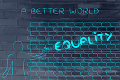Man writing Equality as wall graffiti, caption A better world Stock Images