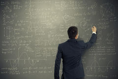 Man writing formulas Royalty Free Stock Photos