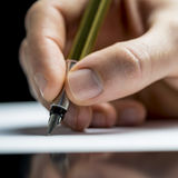 Man writing with a fountain pen royalty free stock images