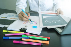 Man writing graph on paper with color pen. Royalty Free Stock Images